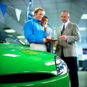 Car Salesman and a Customer --- Image by © Royalty-Free/Corbis